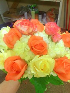 Lisa's wedding bouquet; yellow tinted hydrangea, coral and yellow roses.
