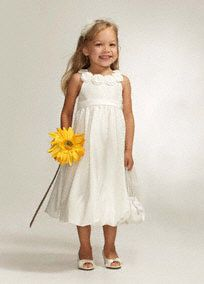 Precious flower girl dress is the perfect pick for your special day.  3D floraldetailadorns the neckline for an adorable accent.  Skirt features darling bubble hem.  Fully lined. Imported polyester. Dry clean only.  Available in Ivory or White