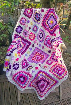 "Shabby Chic Granny Square Throw, by Leonie Morgan; pattern $5.00. Two- to ten-round granny squares first joined in 3 large panels, then panels are joined. About 42"" x 56"" depending on yarn weight & tension, & border. #crochet #afghan #blanket #patchwork"