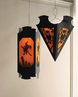 Hanging Vellum Halloween Lanterns | Martha Stewart Living - When the sun goes down, set a spooky scene with these dramatic lanterns made from simple supplies and our exclusive clip-art designs.