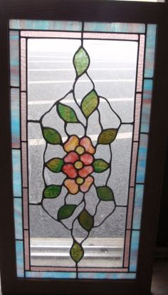 American floral stained glass window.  One of a pairPriced separately New oak frame       Dimensions  16 1/4 x 29 1/4Could be used in either direction