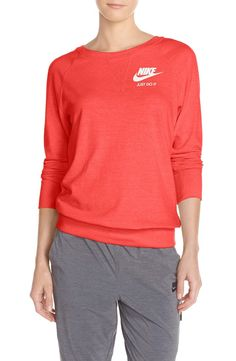 In love with this cozy and cute crewneck by Nike that comes in a variety of bright colors.
