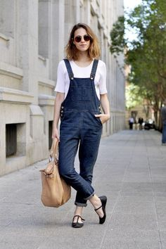 25 Perfect Overalls Outfits for Spring - dark wash denim overalls styled with a white short sleeve top + cargo bag and t-strap flats