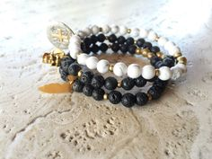Celebrate Tampa Bay's Gasparilla Parade with this Pirate Stretch Stack! Lava stone, Howlite & Gold Dipped Charms <3
