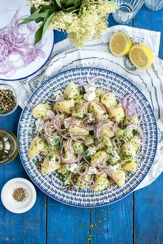 Greek Potato Salad with capers, feta, onions and lashings of lemon juice and olive oil.