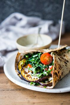 EAT CLEAN with these 20 simple Plant-Based Meals || Grilled Eggplant Wrap with Kale Parsley Slaw and Tahini Sauce | www.feastingathome.com