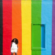 The beautiful Pride Wall in Houston, Texas. Houston wall art is considered a top attraction in Houston. Houston walls are very colorful. Downtown houston photography ✨Houston murals street art ✨ Houston color wall ✨ houston photography locations / Travel in Style / Travel with Style / Black Girls Travel / Women Travel / Natural hair #christobeltravel