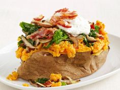 Stuffed Sweet Potatoes with Pancetta and Broccoli Rabe: These loaded sweet potatoes are packed with garlicky vegetables and crispy pancetta and topped with a light ricotta-parmesan sauce spiced with a hint of nutmeg.