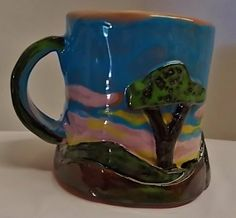 Landscape Mug  glossy, inside and out, and ready to hold your favorite treats: coffee, hot chocolate with whipped cream, ice cream, or jelly beans.  ,,,that would be an awful lot of jelly beans!  Save 15 when you buy two  SailerFineArt, $11.23