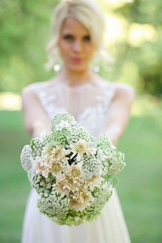 Top Ten Rustic Wedding Bouquet Recipes: Simple but striking - Queen Annes Lace, and cream chrysanthemus for a fall wedding. Nikki Meyer Photo