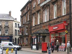 George Hotel Penrith, UK... note the white sidewalk sign: shops to let.  Guess its the same everywhere.