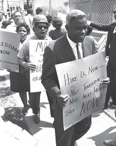 """""""Hire Us Now – Not Tomorrow, Not Next Month, But NOW."""" Pictured here is the baseball player Jackie Robinson, who was also a dedicated civil-rights activist. Robinson marched alongside the Rev. Martin Luther King Jr. and other leaders. Here Robinson..."""