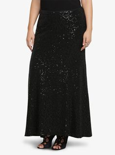 Dazzle them with your style wearing this sexy black sequin skirt. Fitted, with a side zipper entry, the fully lined skirt has the perfect maxi length and literally sparkles as you walk.