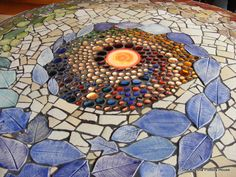 Beautiful mosaic table top. Nice inspiration to make one...someday. Knysna Pottery House