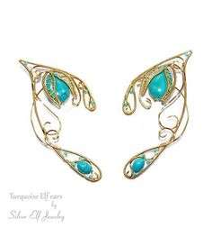 An elegant pair of elf ears, decorated with flowers and veins in true elven spirit.   These elf ears are made of non-tarnish gold plated wire, turquoise and toho beads.   They are perfect for Halloween costumes, fantasy fairytale weddings, renaissance fairs, music festivals, cosplay conventions, parties, raves, gothic fashion shows or just eye-catching everyday jewelry.   Also. they can be the ideal gift for someone who loves the Sea, fantasy jewelry, elvish jewelry, fairy jewelry, LARP or…