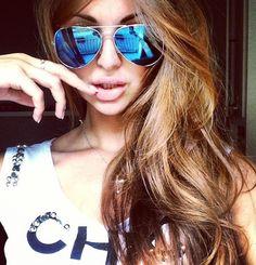 Big hair. Big lips. Big glasses.