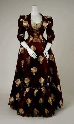 A show-stoppingly beautiful rose patterned, burgundy hued dress from 1883. #Victorian #fashion #dress #1800s #roses