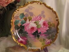 Classic Antique Hand Painted Limoges ROSES Plaque French Artist Pink Burgundy Victorian Roses Highly Collectible China Painting French Master Signed Baumy Vintage Floral Porcelain Charger w Elegant Rococo Gold Border Old French Tea Roses by andrea