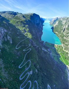 Originally from Brighton, the fine art art photographer yearns to take the perfect shot, which is why he is shows extreme diligence when setting up and snapping each image, like this one (above) captured from a helicopter hovering above Lysefjord