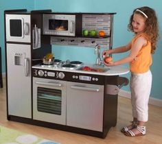 Cute play kitchen ~ trying to find one boyish enough that Daddy will let Bryce have one!