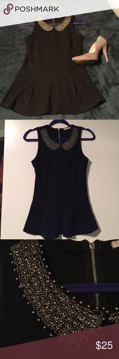 Black peplum top with embellished collar Black peplum top with embellished collar. Tops