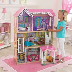 It's time to play house and start decorating! Young girls are sure to jump for joy when they see our Sweet & Pretty Dollhouse. This wooden house is decorated like a peaceful cottage, complete with an