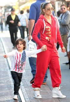 Jennifer Lopez wearing Peace Love World Peace Love World I am Gold Love L2L Tango Fleece hoodie Giuseppe Zanotti Spring 2013 Metal Plate Sneakers