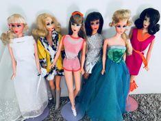 Mod Barbies (l to r): Talking Barbie, Marlo Flip Barbie, Twist 'n Turn Barbie, Living Barbie, Growin' Pretty Hair Barbie, Marlo Flip Barbie