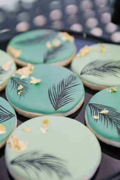 Palm print painted cookies with gold accents