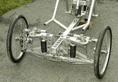 Pictures of homebuilt fully suspended aluminum trike of Julian Edgar from TrikesDigest Quotes from builder: OK. I've been for two decent rides on new trike. Problems are:- Dampers rattle. Trike Bicycle, Recumbent Bicycle, Cargo Bike, Electric Trike, Electric Cars, Three Wheel Bicycle, Solar Car, Reverse Trike, Suspension Design