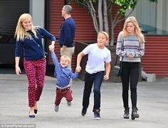 Doting mother: Reese Witherspoon appeared to be in fantastic spirits as she headed out wit...