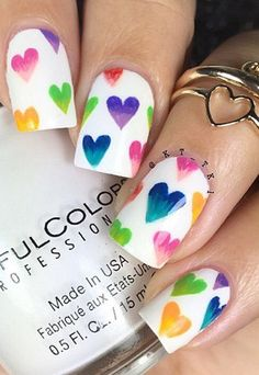 Challenge your skills and creativity through these little ombre hearts on a white nail.
