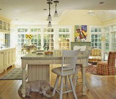 """Another traditional kitchen.  This one is much warmer though.  I think the color on the wall is close to what you were describing - a more """"buttery yellow"""".  Do you agree or is it too close to white?"""