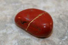 Kintsugi (kintsukuroi) inspired red jasper tumbled stone - OOAK by AKintsugiLife
