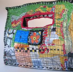 upcycled handbag from itzaChicThing - fused plastic bags + stitching .I like the style - wonder if it's difficult to get a needle through, the hand stitching looks like it might have been? Plastic Bag Crafts, Recycled Plastic Bags, Plastic Grocery Bags, Recycled Art, Fabric Purses, Fabric Bags, Fabric Scraps, Fused Plastic, Art Bag
