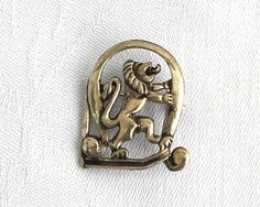 Vintage brooch with standing lion with tongue poking out, pewter colored metal, cast metal, rollover clasp, mid 20th century by CardCurios on Etsy