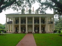 A Southern Plantation home, the extravagance and wealth brought by tobacco, cotton, rice, and slavery