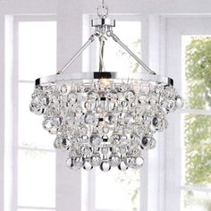Bring a touch of modern charm to your home with this indoor chandelier. Featuring luxurious chrome and elegant teardrop-shaped crystals, the chandelier transforms rooms from humdrum to opulent. Its sl