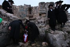 MENAHEM KAHANA/AFP/Getty Images. Ultra-Orthodox Jews fill their plastic containers with water from an ancient mountain spring near Jerusalem on April 6, 2009 during the Maim Shelanu.