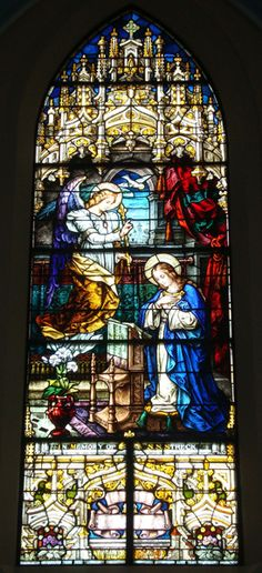 Stained Glass 7 - Annunciation of the Blessed Virgin Mary and reflects the story told by Luke 1:26-38. Note the Virgin Mary, the archangel Gabriel and the dove which is the symbol of the Holy Spirit. The beautiful vase of lilies traditionally is the symbol of Mary's purity.