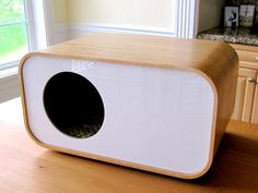 Modern design cat hidey-house from Modern Mews Studio in Seattle.  Cat can also peek thru the back.
