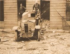 Two firemen and a National Army soldier on a Rolls Royce armoured car outside an unidentified (probably part of 'The Block' Dublin Jube 1922 Armored Car, Armored Vehicles, Michael Collins, Free State, Firemen, Army Soldier, Armed Forces, Rolls Royce, Dublin
