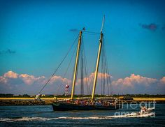 The yacht America sails in to the ocean from Cape May New Jersey. Replica of the Schooner That Launched The America's Cup Tradition