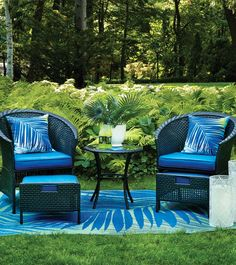Decorate your backyard or patio with a wicker conversation set, perfect for relaxing under the sun this summer.