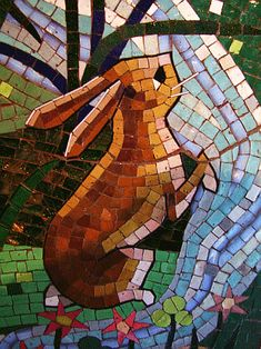 Inside the Castle's archway, a series of five mosaic murals tells the story of Cinderella. Designed by Imagineer Dorothea Redmond and crafted and set in place by a team of six artists led by mosaicist Hanns-Joachim Scharff, the 15 by 10 foot (4.6×3 m), ornate panels are shaped in a Gothic arch.