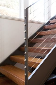 Tinsley Hutson-Wiley Design with cable railings Cable Stair Railing, Modern Stair Railing, Modern Stairs, Deck Railings, Staircase Storage, Staircase Design, Floating Stairs, Entrance Ways, Hall Design