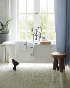 We love this elegant bathroom with striped blue curtains and a dip dyed wooden stool. Diy Bathroom Remodel, Bathroom Renovations, Home Remodeling, Lowes Bathroom, Striped Shower Curtains, Blue Curtains, Coastal Bathroom Decor, Casa Milano, Luxury Duvet Covers