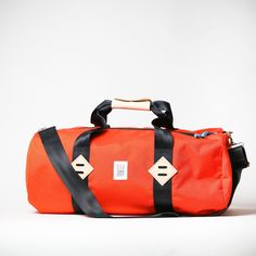 orange travel duffle, travel gear for men #madeinusa, weathered coalition #mensstyle