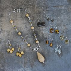 Etsy Transaction -          DeStAsH Sterling Silver Yellow Jade Necklace and 7 pairs of earrings