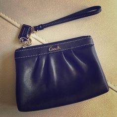 Coach wristlet Looks practically brand new..has a small stain on the back..could see in pictures! Coach Bags Clutches & Wristlets
